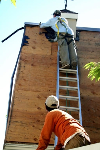 Roofer on ladder