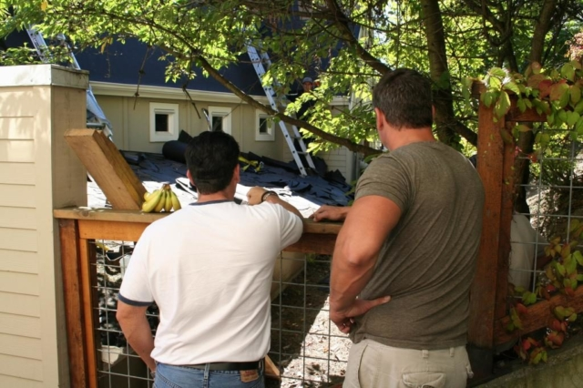 Roofers planning construction